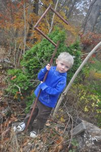 boy in Jack Frost Halloween costume from Rise of the Guardians holding a shepherd's hook, standing in the woods