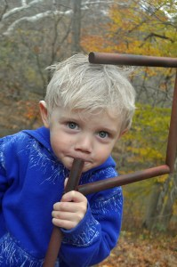 boy in Jack Frost Halloween costume from Rise of the Guardians holding a shepherd's hook and making a silly face