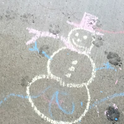 A snowman drawn on the porch with sidewalk chalk