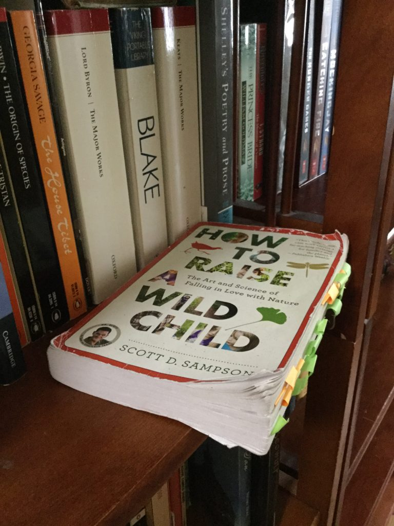 A picture of the book How to Raise a Wild Child by Scott D. Sampson lying on my bookshelf
