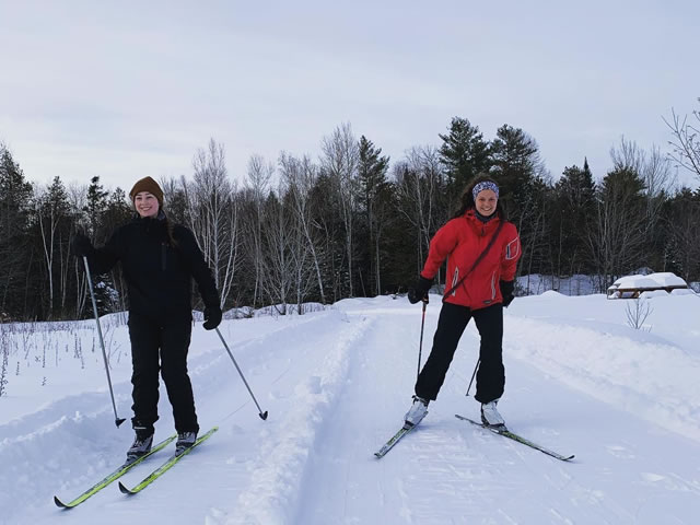 Two women cross country skiing at Fulton's