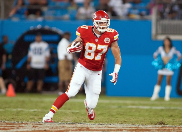 Aug 17, 2014; Charlotte, NC, USA; Kansas City Chiefs tight end Travis Kelce (87) runs after catching a pass during the third quarter against the Carolina Panthers at Bank of America Stadium. Mandatory Credit: Jeremy Brevard-USA TODAY Sports