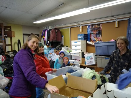 Sorting clothes at the Food Pantry