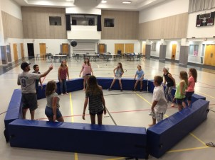 Middle school students playing Gaga ball in the gym