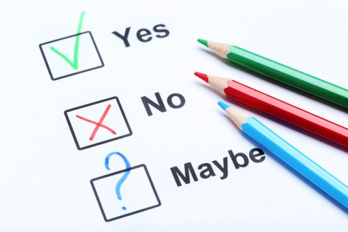 Check boxes yes, no and maybe on white paper