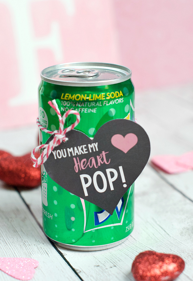 You Make My Heart Pop Valentine Idea. This is such a fun way to say Happy Valentine's Day to classmates, your own kiddos, or coworkers! It's as simple as printing this cute tag and getting a favorite can of pop! #Valentinesday #valentineideas #valentinesdayideas #funvalentines