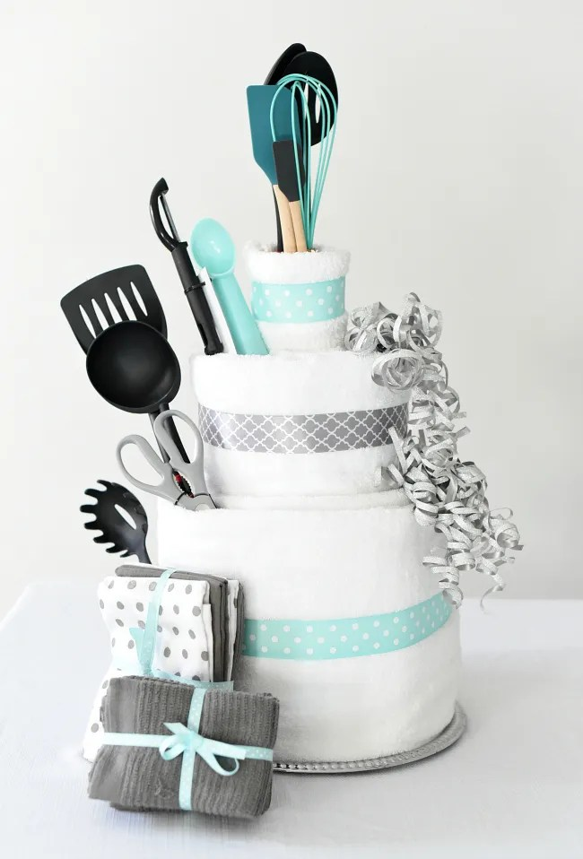 Towel Cake DIY Bridal Shower Gift-This cute towel cake is a fun wedding gift idea or great for a bridal shower. Easy to make and you can personalize it for your recipient! Also makes a great bridal shower centerpiece. #bridalshowerdecorations #weddinggifts #bridalshower #