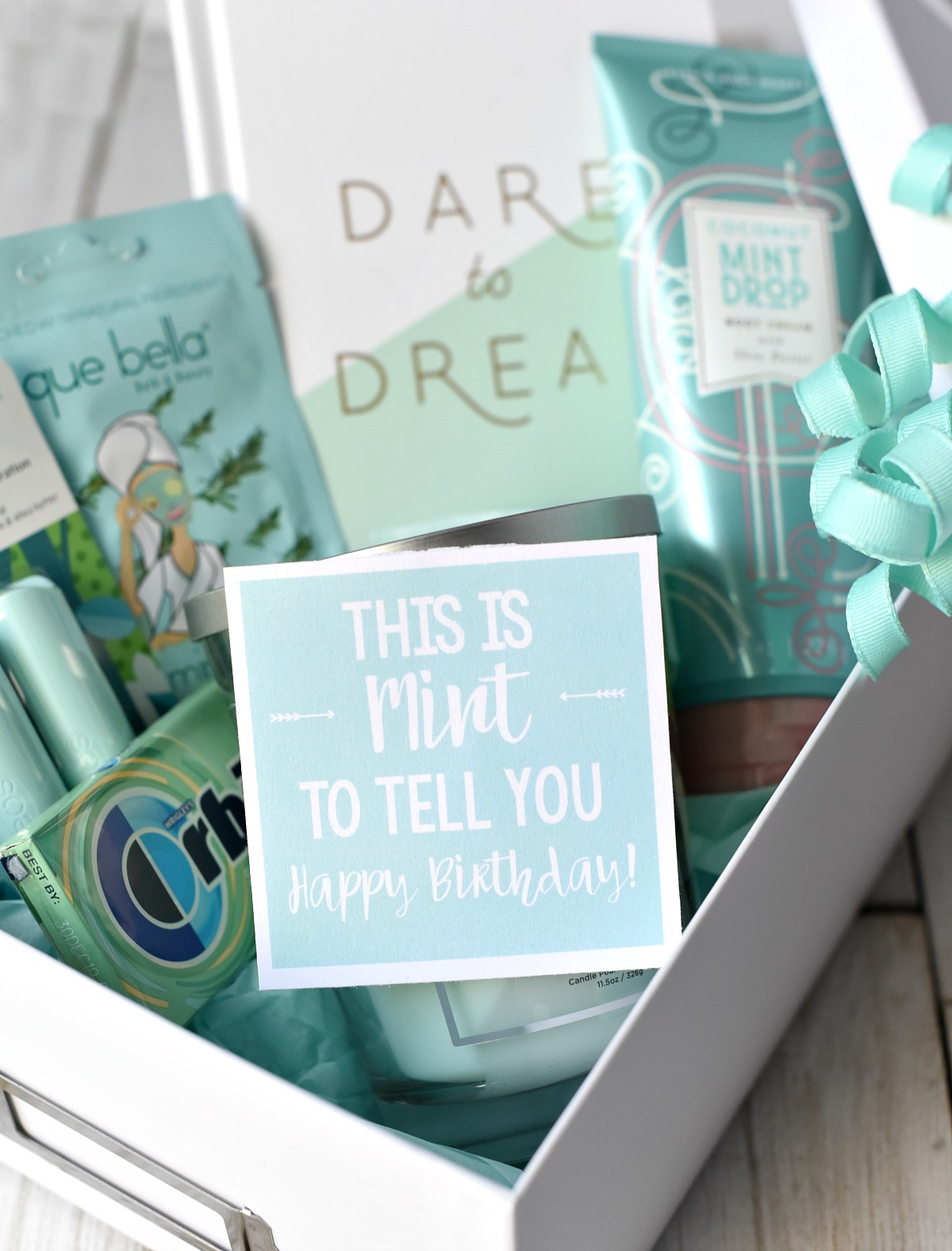"""Mint Themed Gift-This cute gift basket is filled with all things mint and then has a cute """"This is MINT to tell you Happy Birthday!"""" tag attached. So much fun to give and to receive. #giftideas #birthday"""