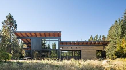 tumble-creek-cabin-steel-beams-overhanging-roof-washington-state-retreat-residential-architecture-countryside-coates-design_dezeen_hero-1