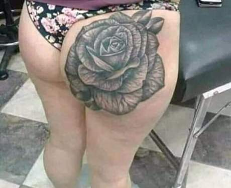 When she was young and slim this was a rose on her ass,now it looks more like a cabbage