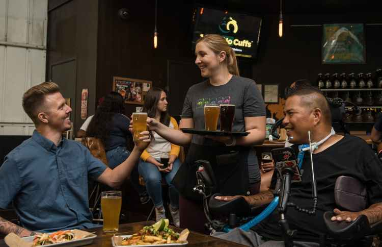 woman serving beer at a bar