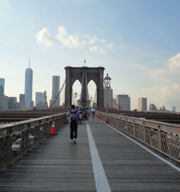 Crossing the Brooklyn Bridge. NYC, USA