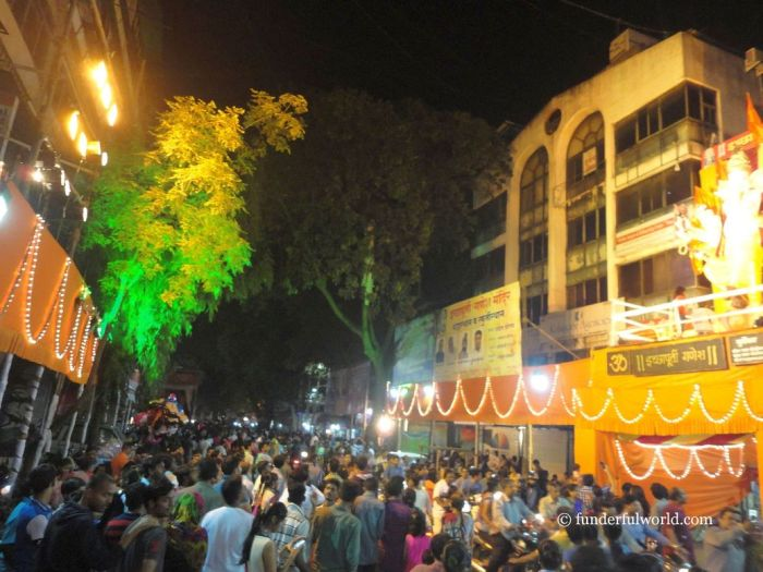Everyone's outside! In the streets of Pune during Ganesh Chaturthi festivities. Maharashtra, India.