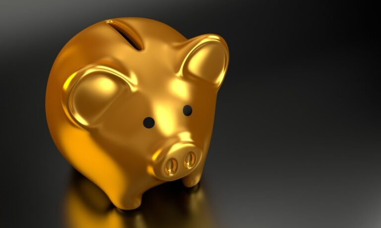 a gold piggy bank on a black background