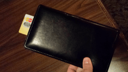 Picture of someone paying a restaurant bill