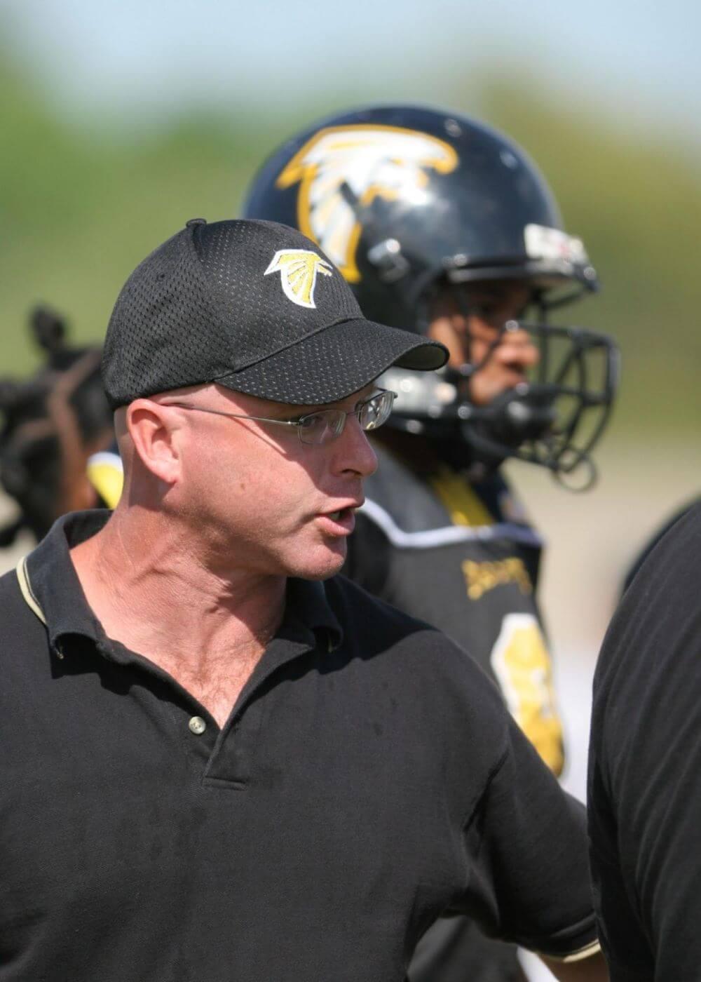a football coach explaining to his team