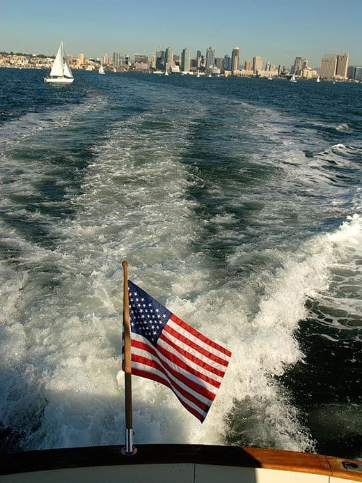 Going to the ocean with yacht flag - San Diego in background