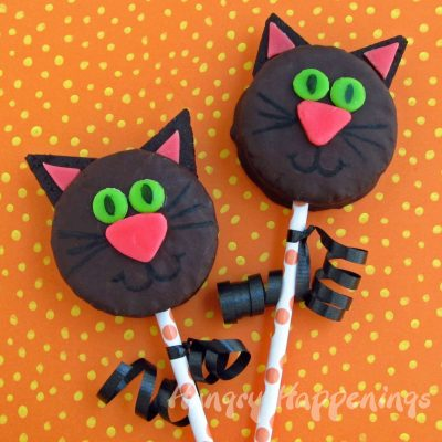 Black Cat Cake pops -October 29th is National Cat day - Sharing our favorite 21 Cat - themed craft activities & books. Free Printable, Art and craft activities and loads of books