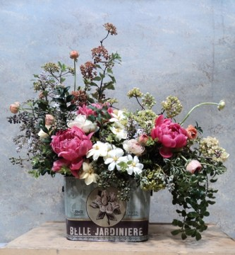 Trend Alert  Vintage Containers for Flowers   Grower Direct Fresh     old tin can used as a container for flowers