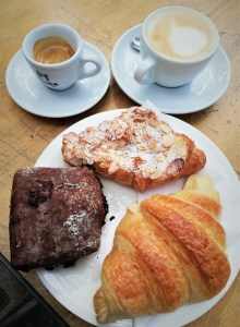 two coffees, croissants and chocolate bun