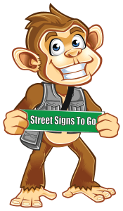"company mascot ""Togo"" with Street Sign"