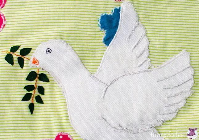 DIY - Kissen mit Friedenstaube applizieren