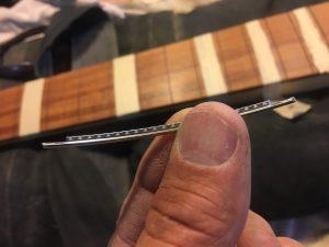 Fret wire. Fretboard blurred image background.