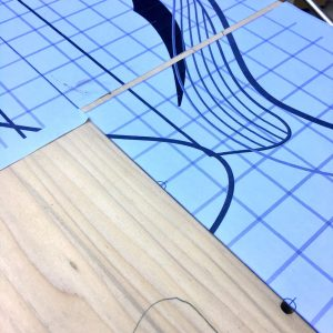 Laying out a paper template to cut the sound hole and control cavity