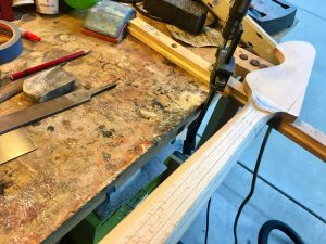 Carving facets into a bass neck