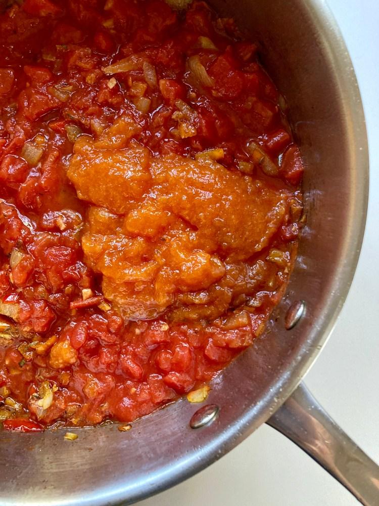 persimmon marinara sauce in a skillet