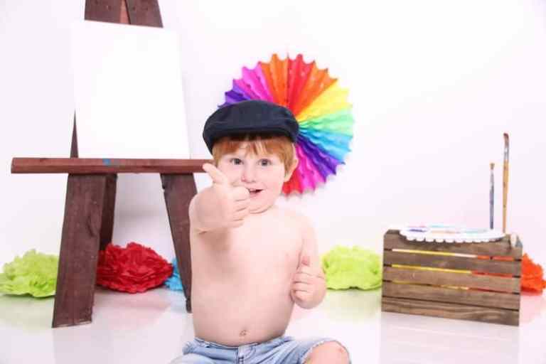 toddler giving thumbs up