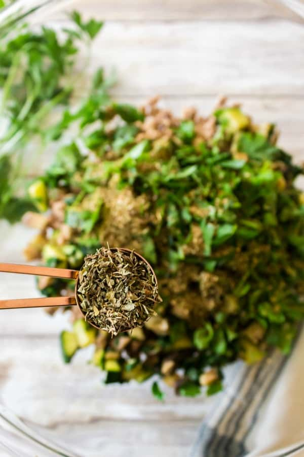 Adding herbs to baked ziti ingredients