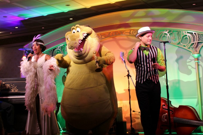 Tiana performs a few numbers with Louis The Alligator during dinner