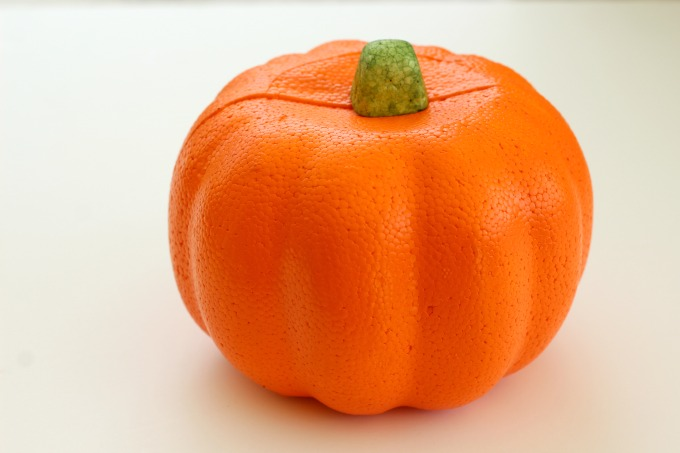 You can easily make a cute spiderweb pumpkin out of a cheap, foam pumpkin.
