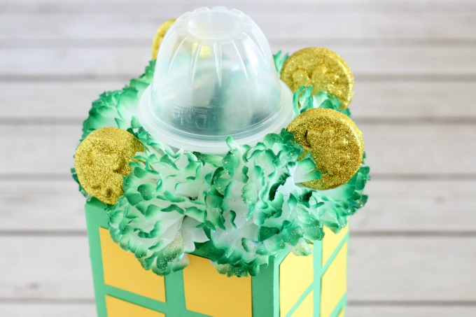 Add flowers and coins to make the rooftop garden for your leprechaun trap.
