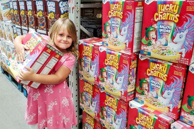Keira picking out Lucky Charms at Sam's Club