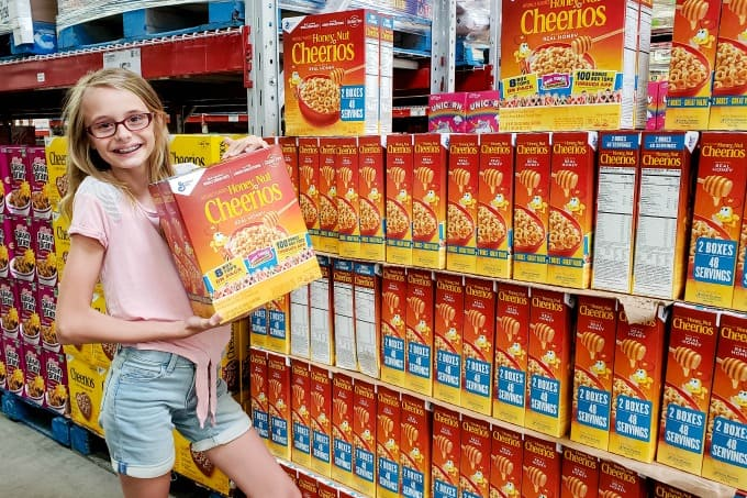 Ashling with a box of Honey Nut Cheerios with the Box Tops logo.