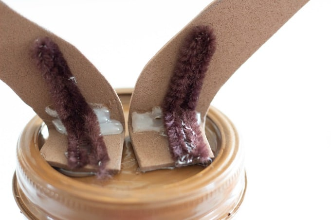 Secure antlers to your reindeer mason jar with chenille and hot glue