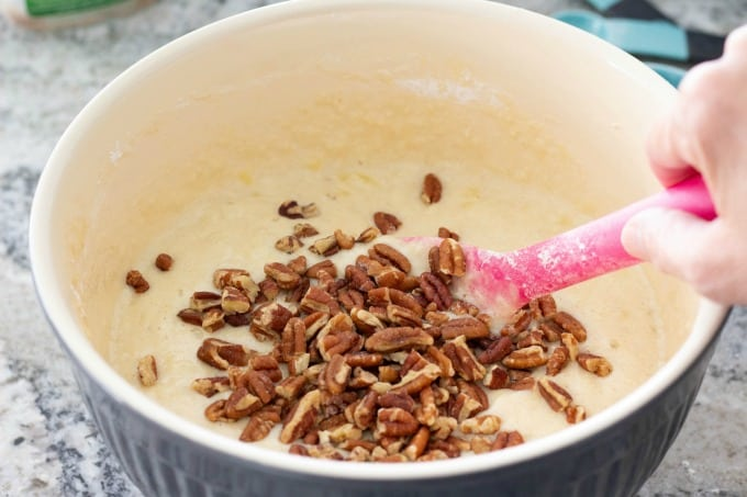 Adding pecans to healthy banana bread