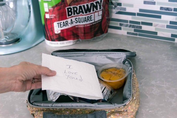 Putting Brawny paper towel in lunch box