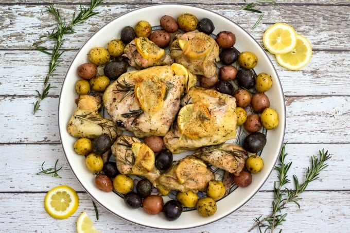 Lemon rosemary chicken on plate with potatoes