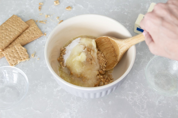 Mixing ingredients for graham cracker crust