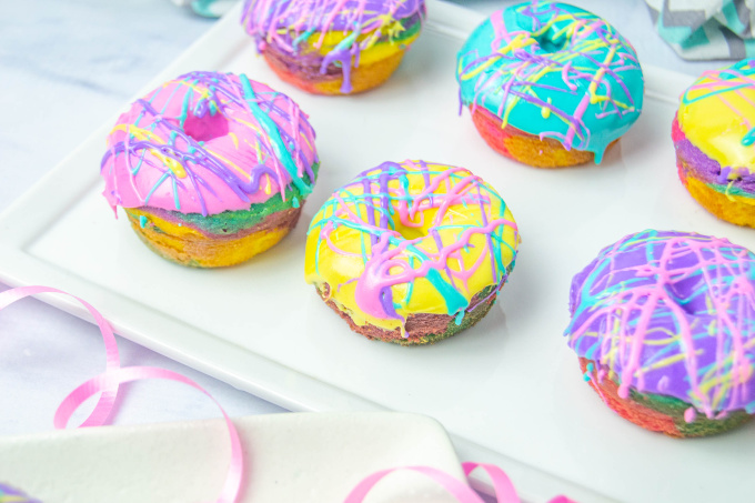 Different colored cake mix donuts on plate