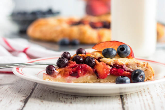 A slice of blueberry peach galette on a plate
