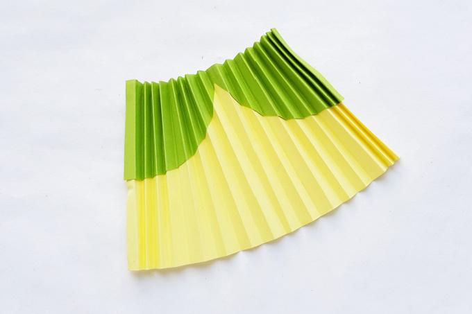 Tiana's dress folded accordian style