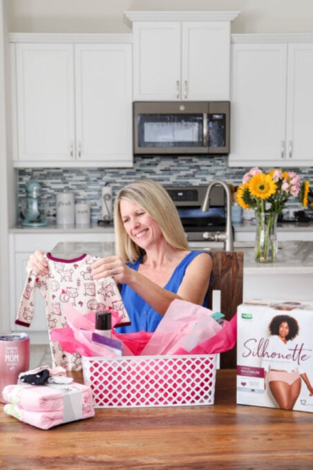 Putting together a gift basket for new moms