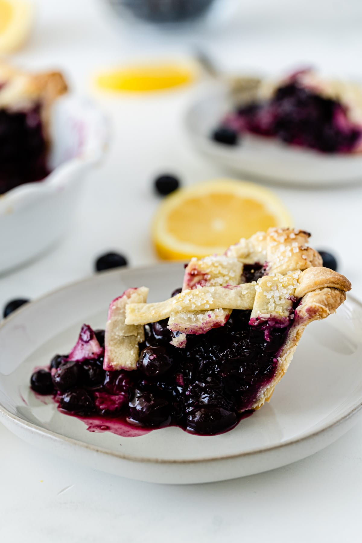 Blueberry pie filling falling out of pie onto plate