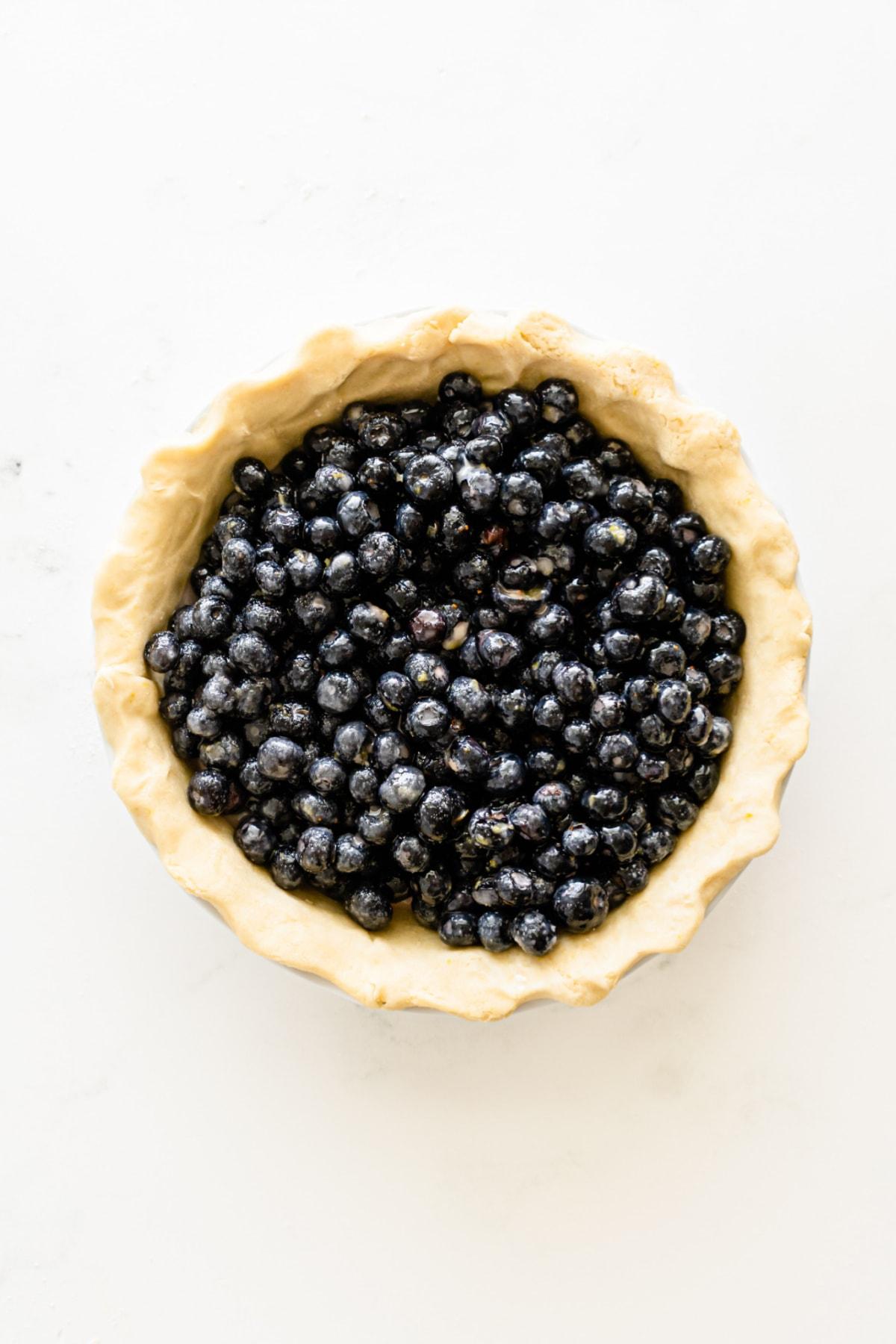 Blueberry pie mixture in pie pan