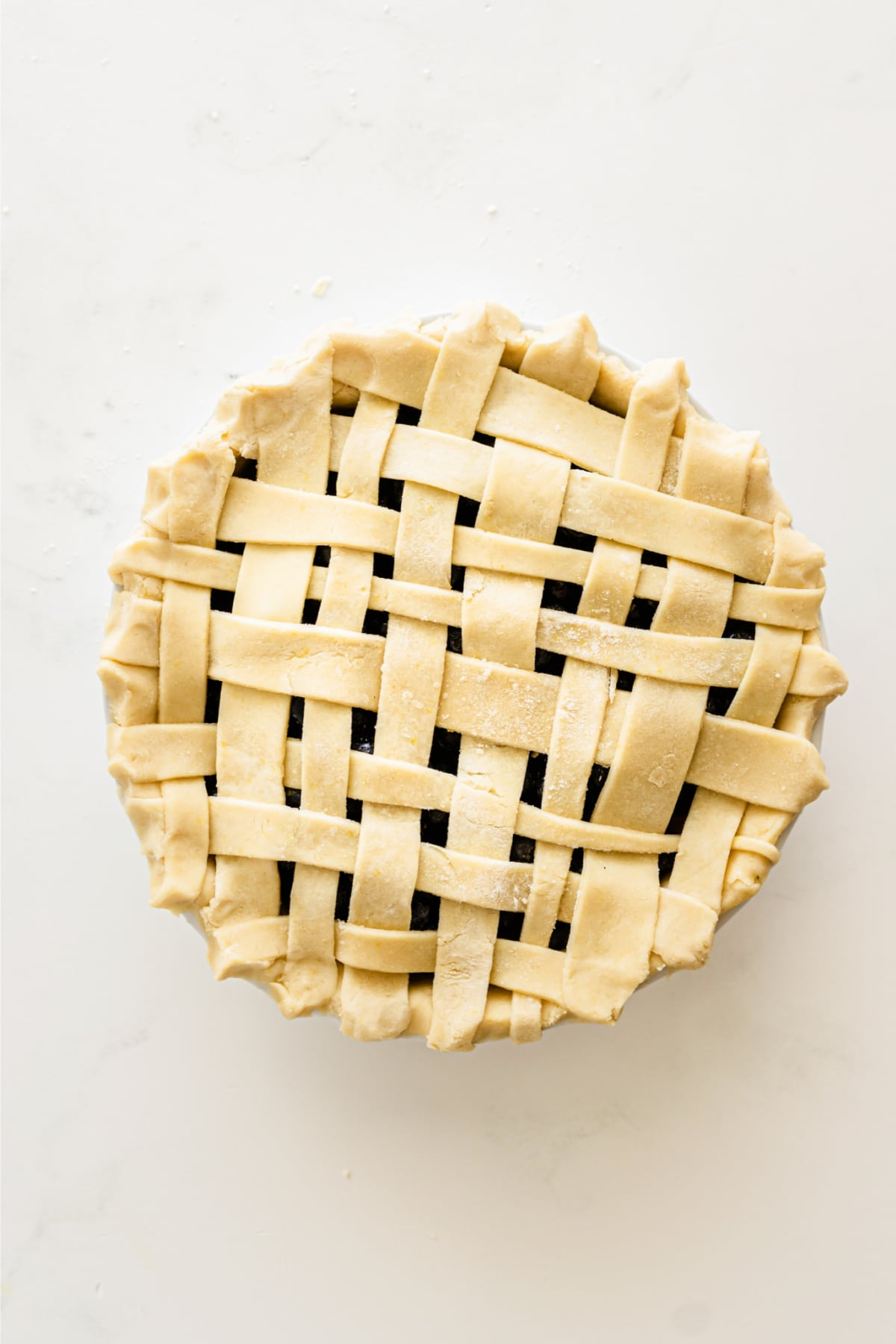 Uncooked blueberry pie with a lattice crust