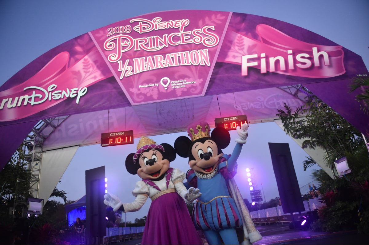 Mickey and Minnie Mouse at runDisney, where AdventHealth gives support and first aid at Disney World